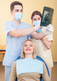 Dentist man and female assistant Stock Images