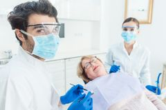 Dentist man in his surgery Stock Images