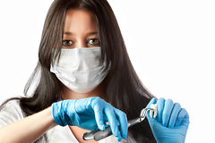 Dentist in mask holding forceps and tooth isolated Stock Images