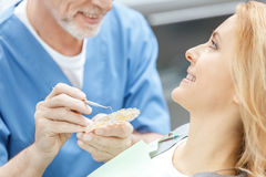 Dentist matching teeth colour with palette stock photos