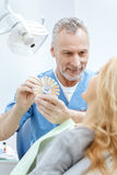 Dentist matching teeth colour with palette stock image