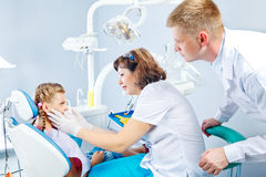 Dentist, medical assistant and a kid Stock Images