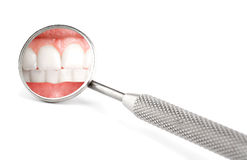 Dentist mirror. With reflection of teeth Stock Image