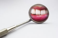 Dentist mirror with reflection of teeth Stock Image