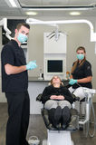 Dentist with nurse and patient Stock Images