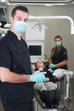 Dentist with nurse and patient Stock Image