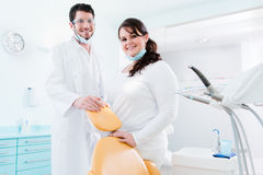 Dentist and nurse in their clinic as team Stock Image