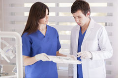 Dentist and nurse working together Royalty Free Stock Photos