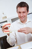 Dentist offering tips for brushing Royalty Free Stock Images