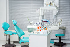 Dentist office. Chair and equipment Stock Photos