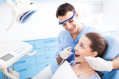 Dentist office. Male dentist and women in dentist's office Stock Photo