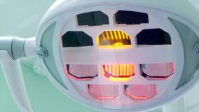 Dentist medical lamp turning on and off stock video footage