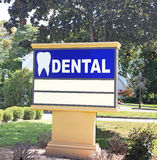 Dentist Office Sign. On a large board with a tooth and the word dental Royalty Free Stock Photography