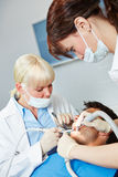 Dentist operates in patient with toothache Royalty Free Stock Photography