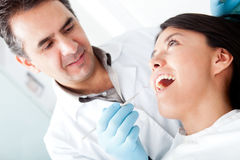 Dentist with a patient Royalty Free Stock Photos