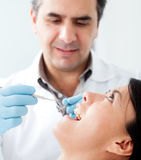 Dentist with a patient Stock Photography