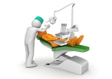 Dentist and patient in dental chair Royalty Free Stock Image
