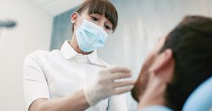 Dentist and patient in dentist office. Dental Hygiene. Oral Health, Tooth Care Concept stock footage
