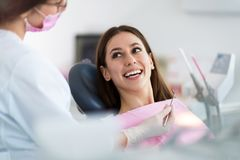 Dentist and patient in dentist office Stock Photos