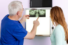 Dentist and patient discussing an x-ray. Stock Image
