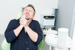 Dentist patient expressing tooth pain or toothache Royalty Free Stock Photography