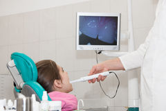 Dentist and patient. Girl is being treated by a dentist Stock Images