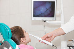 Dentist and patient. Girl is being treated by a dentist Stock Photography
