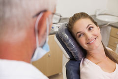 Dentist and patient smiling at each other Stock Photo