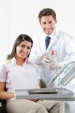 Dentist And Patient With Teeth Model In Clinic stock photos