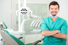 Dentist. A portrait of the smiling young man, dentist at his office stock photography