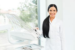Dentist Portrait. Woman Smiling at her Workplace. Dental Clinic Royalty Free Stock Photography
