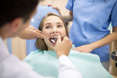Dentist prepare mouth for repairing teeth Royalty Free Stock Images
