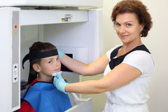 Dentist prepares boy wearing in protective lead Royalty Free Stock Image