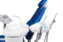 Dentist professional medical equipment with chair isolated on white. Dentist professional medical equipment isolated on white royalty free stock photo