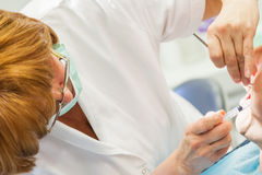 Dentist Provides Anesthesia To Patient Stock Photo