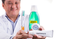 Dentist recommend tapered bristle toothbrush, toothpaste, mouthw Royalty Free Stock Photography