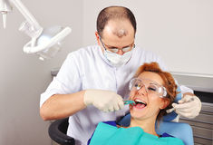 Dentist removes tooth Royalty Free Stock Photo
