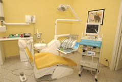 Dentist's chair. Modern studio with dentist chair in yellow Royalty Free Stock Photo