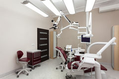 Dentist's chair. In a medical room Royalty Free Stock Photography
