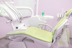 Dentist's chair in a medical room Royalty Free Stock Photos