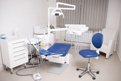 Dentist's chair in a medical room Stock Photos