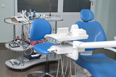 Dentist's chair in a medical room Royalty Free Stock Images