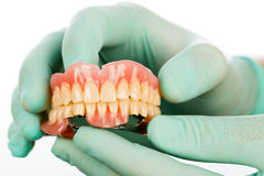 Dentist 's hands and dental product Stock Photos
