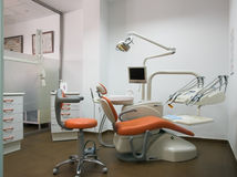 Dentist's machine. With orange chair Stock Photos