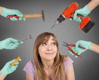 Dentist scary crazy tools. Frightened girl from crazy tools of dentist Royalty Free Stock Photos