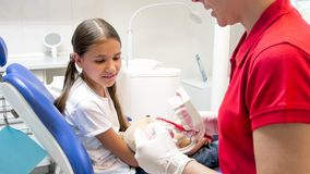 Pediatric dentist showing how to use toothbrush to her little patient Stock Photography