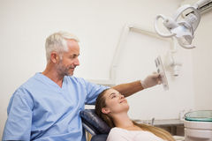 Dentist showing patient her xrays Royalty Free Stock Photos