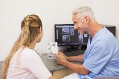 Dentist showing patient her xrays Stock Photo