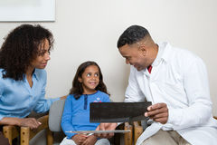 Dentist showing patient x ray Stock Photos