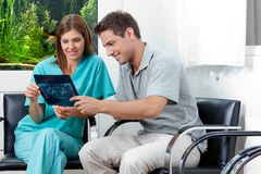 Dentist Showing X-Ray Report To Man Stock Photos